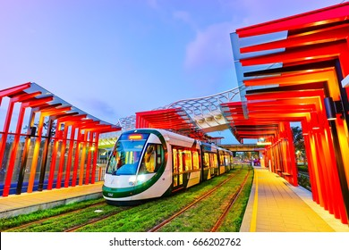 Kaohsiung, Taiwan - April 15, 2017: View of a light rail tram stopped in a modern station at dusk in Kaohsiung, Taiwan on April 15, 2017.