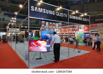 KAOHSIUNG, TAIWAN -- APRIL 5, 2019: Visitors at a sales and promotional fair for electric household appliances look at flat screen TVs.