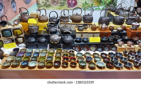 KAOHSIUNG, TAIWAN -- APRIL 5, 2019: A stall sells teapots and teacups at a sales and promotion event.