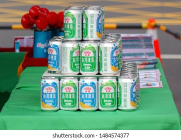 KAOHSIUNG, TAIWAN -- AUGUST 3, 2019: A street vendor sells cans of Taiwan Beer at an outdoor event.