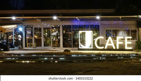 KAOHSIUNG, TAIWAN -- DECEMBER 1, 2018: A coffee shop at evening time. It is located in the Central Park in downtown Kaohsiung.