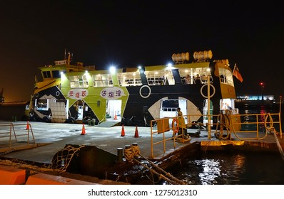 KAOHSIUNG, TAIWAN -- DECEMBER 22, 2018: A cross-harbor ferry boat is docked at the pier waiting for travelers to board.