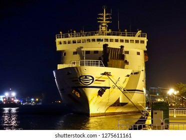 KAOHSIUNG, TAIWAN -- DECEMBER 22, 2018: A large car and truck ferry between Taiwan and the outlying islands is anchored at the pier by night.