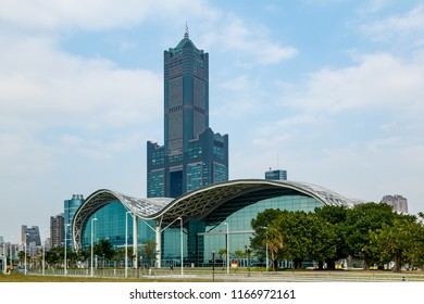 Kaohsiung, Taiwan - December 29 2015: Waterfront side of Kaohsiung Exhibition center. Behind, the Kaohsiung 85 Building also known as Tuntex Sky Tower.