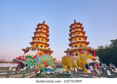 Kaohsiung, Taiwan - December 3, 2018: People come to merit at Cih Ji Dragon and Tiger Pagodas on lotus pond in sunset time at Zuoying district, Kaohsiung city, Taiwan.