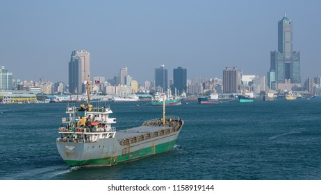 Kaohsiung, Taiwan - December 30 2015: Kaohsiung, Taiwan: Cargo ship En Cheng entering the harbour of Kaohsiung.