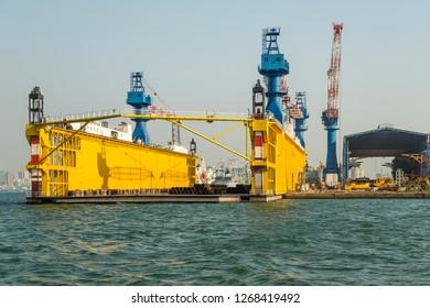 Kaohsiung, Taiwan - December 30 2015: Floating drydock Jong Shyn No. 8 of Jong Shyn Shipbuilding Group in Kaohsiung Harbour.
