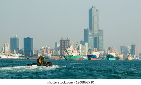 Kaohsiung, Taiwan - December 30 2015: Ships mooring in Kaohsiung Harbour with the Tuntex Sky Tower in the background