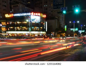 KAOHSIUNG, TAIWAN -- DECEMBER 8, 2018: Busy traffic during evening rush hour in downtown Kaohsiung. The image features motion blur.