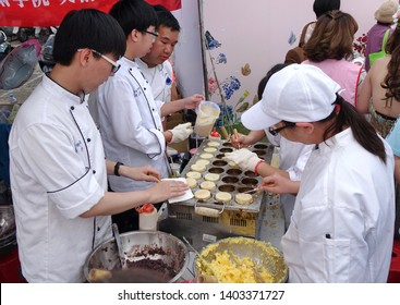 KAOHSIUNG, TAIWAN -- DECEMBER 8, 2018: Cooking school students make red bean cakes, or Imagawayaki, as the Japanese call it, a popular sweet food in Taiwan.