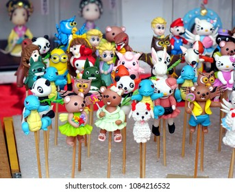 KAOHSIUNG, TAIWAN -- FEBRUARY 16, 2018: A street vendor sells colorful dough figurines, a Chinese traditional folk art with a modern twist.