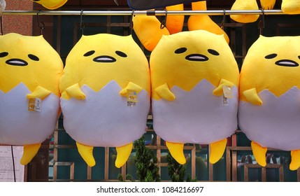 KAOHSIUNG, TAIWAN -- FEBRUARY 17, 2018: A street vendor sells large dolls based on the Japanese cartoon character Gudetama.