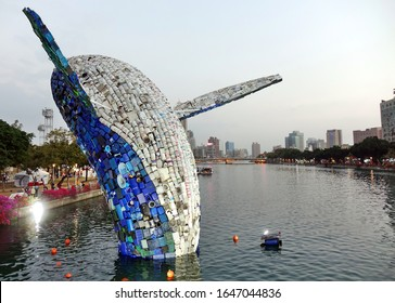 KAOHSIUNG, TAIWAN -- FEBRUARY 6, 2020: A giant whale statue made from recycled plastic and metal is set up in a downtown area of the Love River.