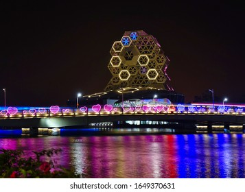 KAOHSIUNG, TAIWAN -- FEBRUARY 6, 2020:: Evening view of the Love River bridge with the illuminated pop music center during the Lantern Festival
