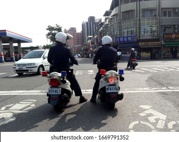 Kaohsiung, Taiwan, February 6, 2020: Taiwan police patrol the streets on motorcycles.