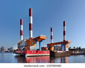 KAOHSIUNG, TAIWAN -- FEBRUARY 7, 2019: A floating dock construction rig is at work in Kaohsiung Harbor at a bridge building project.