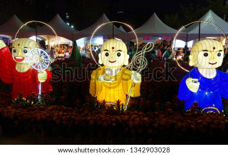 KAOHSIUNG, TAIWAN -- FEBRUARY 9, 2019: Three lanterns in the shape of Buddhist monks are on display at the Lantern Festival.