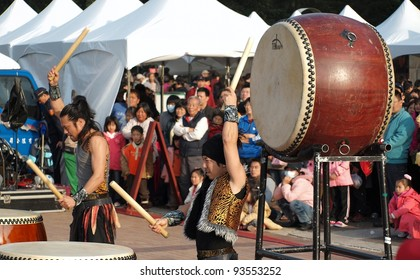 KAOHSIUNG, TAIWAN - JANUARY 23: The Japanese percussion group TenDrum performs outside the Cultural Center for the Chinese New Year on January 23, 2012 in Kaohsiung
