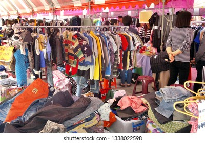 KAOHSIUNG, TAIWAN -- JANUARY 24, 2019: Shoppers and sellers at an outdoor market for used clothing.