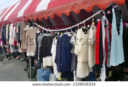 KAOHSIUNG, TAIWAN -- JANUARY 24, 2019: A display of dresses at an outdoor market for used clothing.