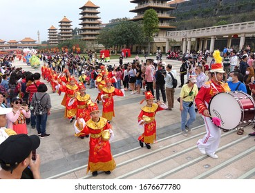 KAOHSIUNG, TAIWAN -- JANUARY 25, 2020: A parade at the Fo Guang Shan Buddhist complex during Chinese New Year with children dressed up as Chinese scholars.