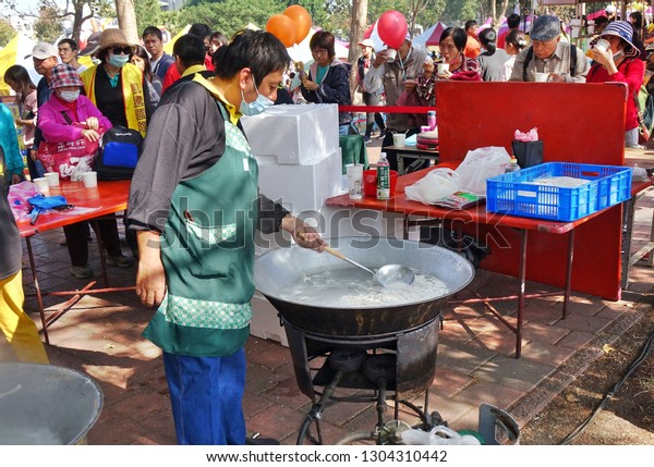 KAOHSIUNG, TAIWAN -- JANUARY 5, 2019: A man cooks fish soup in a large wok at the Luzhu Tomato Festival.