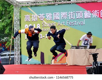 KAOHSIUNG, TAIWAN -- JULY 14, 2017: Two male dancers participate in the hip-hop competition at the 2018 Street Art Festival.