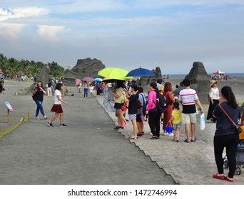 KAOHSIUNG, TAIWAN -- JULY 27, 2019: Tourists at the Black Sand Beach festival on Chijin Island.
