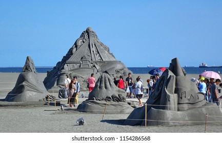 KAOHSIUNG, TAIWAN -- JULY 29, 2018: Visitors enjoy the sand sculptures at the 2018 Chijin Island Black Sand Festival.