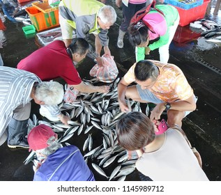 KAOHSIUNG, TAIWAN -- JULY 8, 2018: Buyers choose fresh fish at the Sinda Fishing Port.