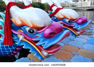KAOHSIUNG, TAIWAN -- JUNE 1, 2019: Boats with the traditional dragon head sculpture design are prepared for the yearly Dragon Boat Races on the Love River.