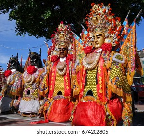KAOHSIUNG, TAIWAN -- JUNE 10 , 2017: A set of large elaborate masks and costumes worn by dancers to represent deities popular in Taiwan's folk religion.