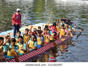 KAOHSIUNG, TAIWAN -- JUNE 10, 2018: A team of junior high school students prepares for the upcoming Dragon Boat Races.