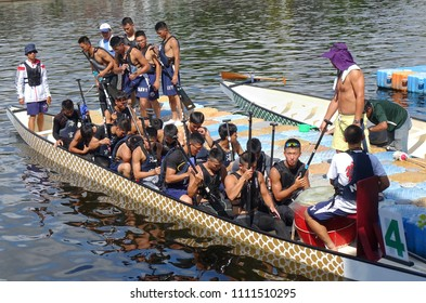 KAOHSIUNG, TAIWAN -- JUNE 10, 2018: A team of sailors from the navy prepares for the upcoming Dragon Boat Races.