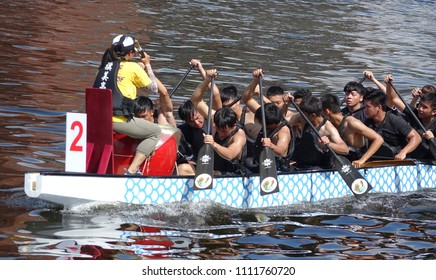 KAOHSIUNG, TAIWAN -- JUNE 10, 2018: A team of students trains for the upcoming Dragon Boat Races.