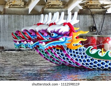 KAOHSIUNG, TAIWAN -- JUNE 10, 2018: A row of dragon boats with the traditional figureheads is being prepared for the upcoming Dragon Boat Festival.