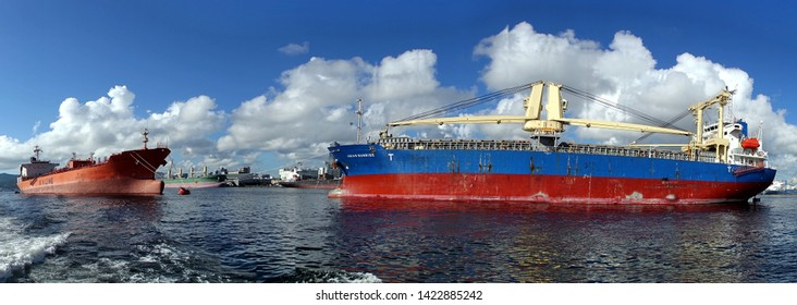 KAOHSIUNG, TAIWAN -- JUNE 2, 2019: Two large cargo ships are docked in Kaohsiung Port