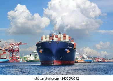 KAOHSIUNG, TAIWAN -- JUNE 2, 2019: A large container ship is getting ready to leave Kaohsiung Port.