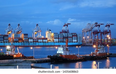 KAOHSIUNG, TAIWAN -- JUNE 2, 2019: A view of the busy Kaohsiung container shipment port at evening time.