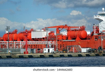 KAOHSIUNG, TAIWAN -- JUNE 2, 2019: A large chemical tanker unloads its cargo at Kaohsiung Port.