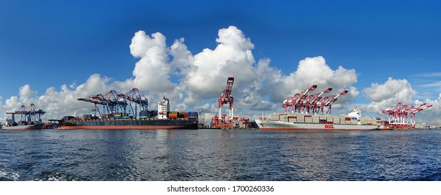 KAOHSIUNG, TAIWAN -- JUNE 2, 2019: Containers are being loaded onto ships in Kaohsiung Port.
