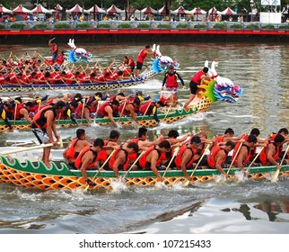 KAOHSIUNG, TAIWAN - JUNE 23: Four unidentified teams compete in the 2012 Dragon Boat Races on the Love River on June 23, 2012 in Kaohsiung
