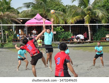 KAOHSIUNG, TAIWAN -- JUNE 27, 2019: People play beach volleyball during the Chijin Black Sand Festival.