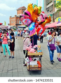 KAOHSIUNG, TAIWAN -- JUNE 27, 2019: A street vendor sells balloons on the main tourist street on Chijin Island.