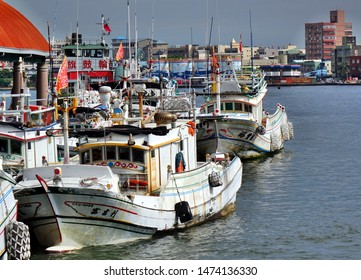KAOHSIUNG, TAIWAN -- JUNE 27, 2019: Traditional Chinese fishing boats are anchored at the Gushan Ferry Pier.