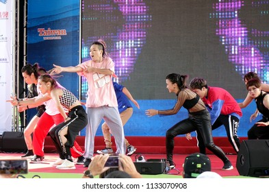 KAOHSIUNG, TAIWAN -- JUNE 30, 2018: Young people perform a hip-hop dance at the opening of the Love River Festival, a free, public outdoor event.
