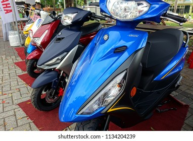 KAOHSIUNG, TAIWAN -- JUNE 30, 2018: Electric environmentally friendly scooters are on display at public event.