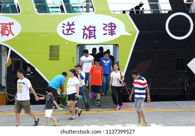 KAOHSIUNG, TAIWAN -- JUNE 30, 2018: Passengers disembark from the new cross-harbor ferry which is powered by electricity and features the popular black bear mascot.