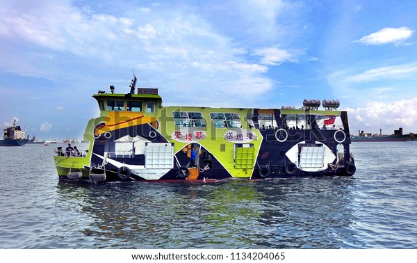 KAOHSIUNG, TAIWAN -- JUNE 30, 2018: This new cross-harbor ferry is powered by electricity and features the popular black bear mascot.