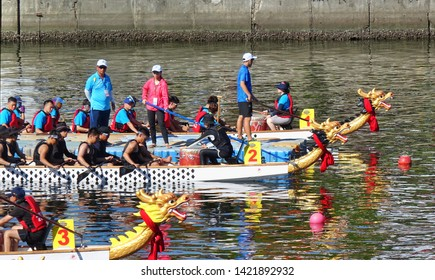 KAOHSIUNG, TAIWAN -- JUNE 7, 2019: Teams are positioning themselves at the starting line for the Love River dragon boat races.
